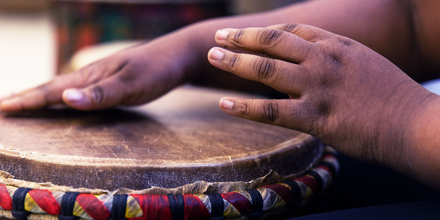 Hands on an African drum.